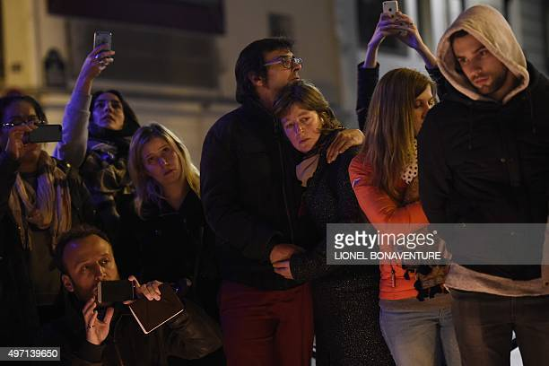 """People gather near the """"Belle Equipe"""" restaurant, the site of one of the attacks in Paris on November 14, 2015. Islamic State jihadists claimed a..."""