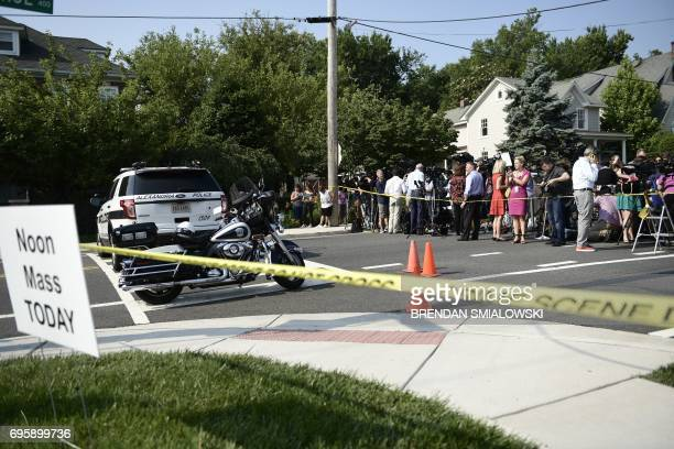 People gather near the scene of an early morning shooting in Alexandria Virginia June 14 2017 Senior Republican Congressman Steve Scalise was among...