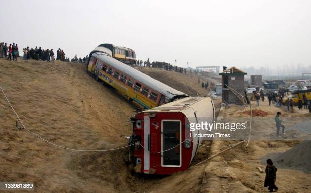 People gather near the site of a derailed passenger train 70 km south of Srinagar which was travelling from Qazigund on November 23 2011 in Sadura...