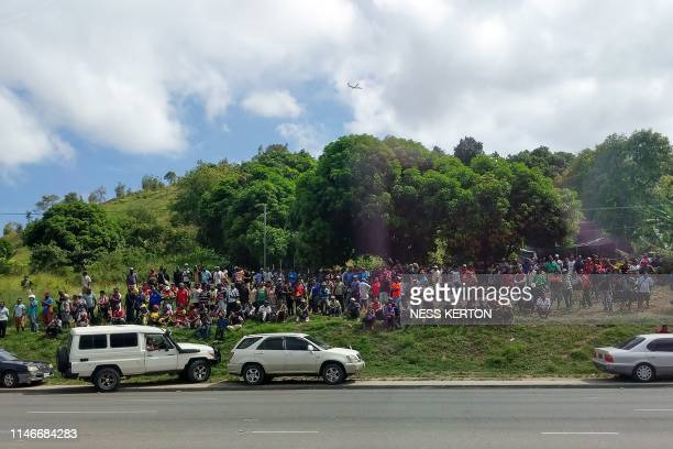 People gather next to a road blocked off by police which leads to Parliament house in Port Moresby on May 28 2019 Papua New Guinea Prime Minister...