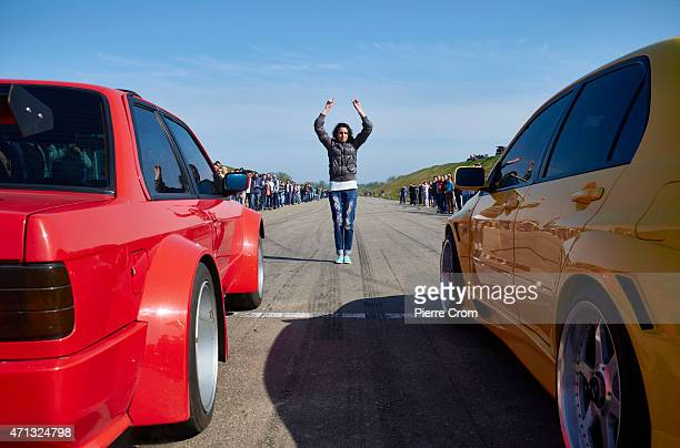 People gather on a abandoned road to watch or participate in street racing on the outskirts of Odessa on April 26 2015 in Odessa Ukraine Although...