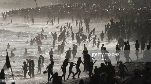People gather on a hot winter day on Ipanema beach on the Atlantic Ocean on September 8 2017 in Rio de Janeiro Brazil According to NOAA global...