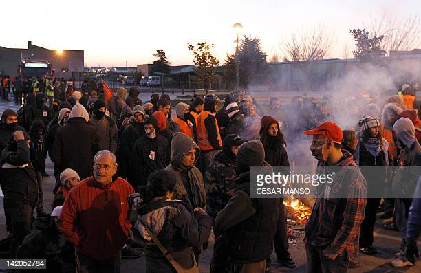 People gather on a parking lot of the transport bus company during a national strike in Burgos on March 29, 2012. Unions have called a national...