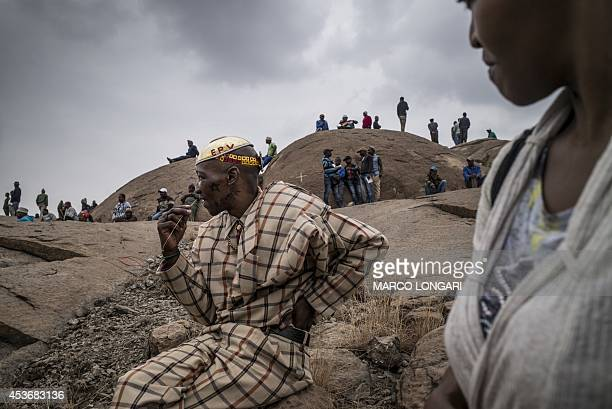 People gather on August 16 2014 in front of the hill where two years ago miners where gunned down by the South African police during a violent wave...