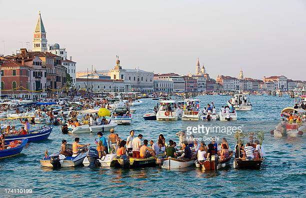 People gather on boats of all sizes at Punta della Dogana in St Mark's basin for the Redentore Celebrations on July 20 2013 in Venice Italy Redentore...