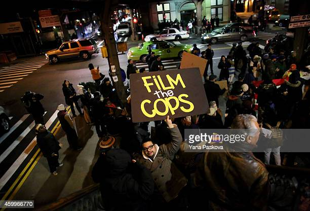 People gather on E 125th St during a protest December 4 2014 in New York City Protests began after a Grand Jury decided to not indict officer Daniel...