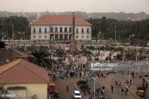 People gather on 'Empire Square' during GuineaBissau's Mardi Gras carnival in Bissau on February 13 2018 / AFP PHOTO / Xaume Olleros