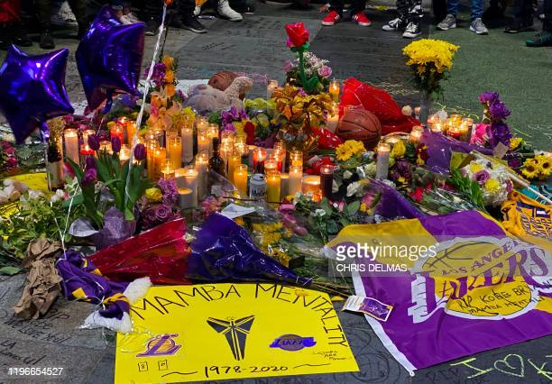 People gather on January 26 2020 around a makeshift memorial in downtown Los Angeles as they pay tribute to former NBA and Los Angeles Lakers player...
