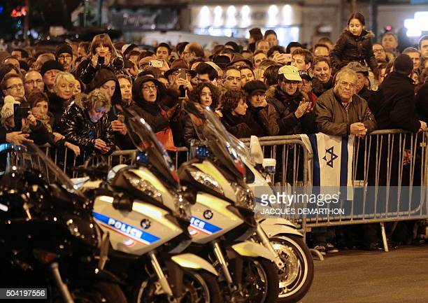 People gather on January 9 2016 near the Hyper Cacher a kosher supermarket during a ceremony organized by the Council of French Jewish Institutions...