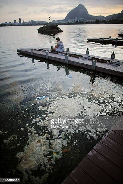 People gather on Lagoa Rodrigo de Freitas which will host rowing and canoeing events in the Rio 2016 Olympic Games on December 3 2013 in Rio de...