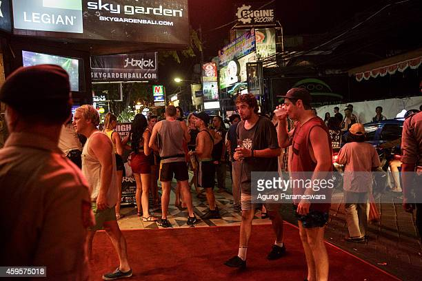 People gather on Legian Street during Australian 'schoolies' celebrations on November 26 2014 in Kuta Bali Indonesia This year around 6000 students...