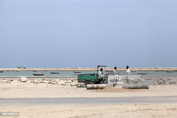 People gather on Marine Drive in Gwadar Balochistan Pakistan on Tuesday July 4 2018 What used to be a small fishing town on the southwestern corner...