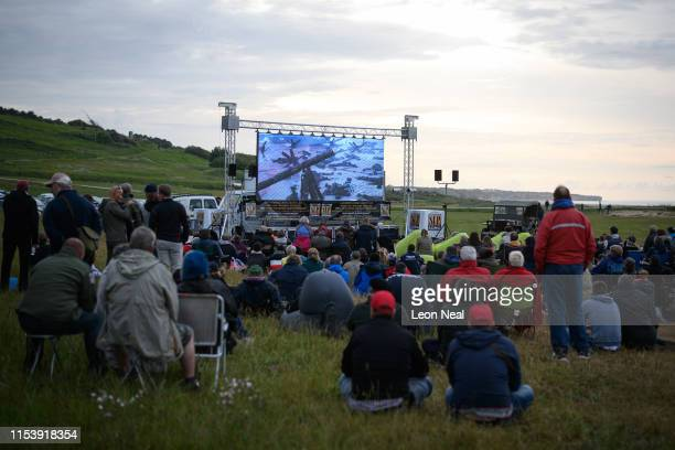 "People gather on Omaha Beach to watch an outdoor screening of the World War II film ""Saving Private Ryan"" on June 05, 2019 in Colleville-Sur-Mer,..."