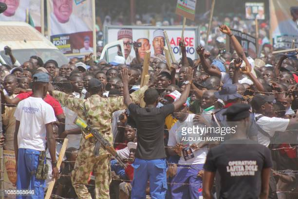 People gather on Ramat Square in Maiduguri northeastern Nigeria to attend a campaign rally held by Nigerian President on January 21 2019 Nigerian...