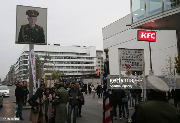 People gather on the 27th anniversary of the fall of the Berlin Wall at Checkpoint Charlie in Berlin Germany on November 5 2017 The Berlin Wall was a...