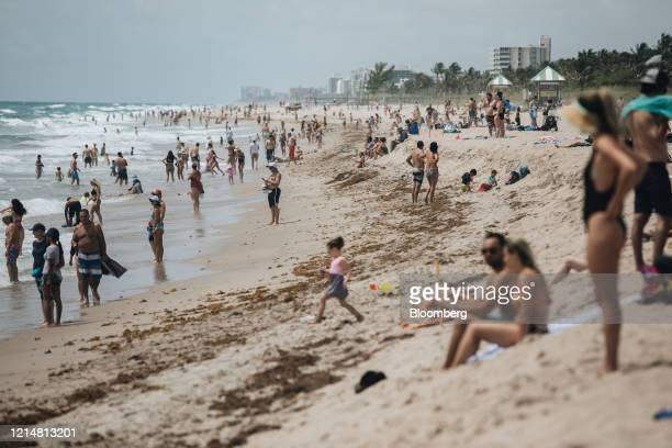People gather on the beach Delray Beach, Florida, U.S., on Saturday May 23, 2020. Palm Beach County beaches reopened this week, ahead of the Memorial...