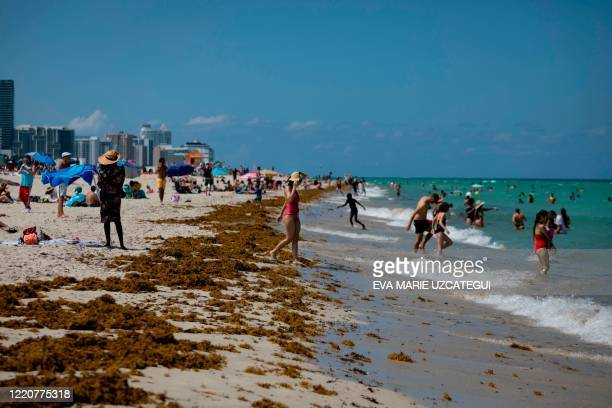 People gather on the beach in Miami Beach Florida on June 16 2020 Florida is reporting record daily totals of new coronavirus cases but you'd never...