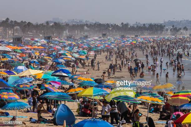 People gather on the beach on the second day of the Labor Day weekend amid a heatwave in Santa Monica, Caifornia on September 6, 2020.