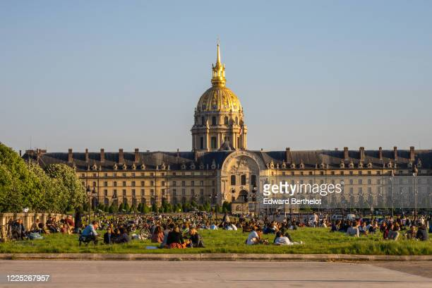 People gather on the lawn and are having a picnic, in front of the Hotel des Invalides, on May 16, 2020 in Paris, France. The Coronavirus pandemic...