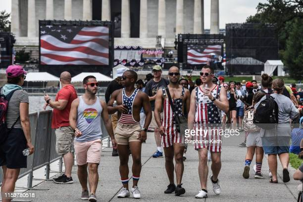 People gather on the National Mall ahead of President Trump's speech during Fourth of July festivities on July 4 2019 in Washington DC President...