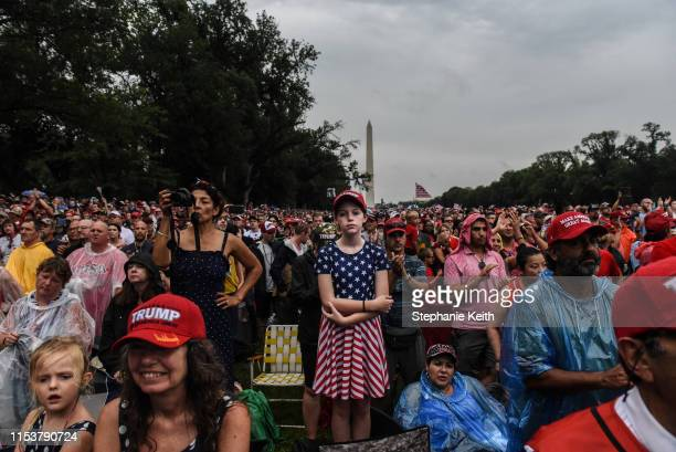 People gather on the National Mall during President Donald Trump's speech during Fourth of July festivities on July 4 2019 in Washington DC President...