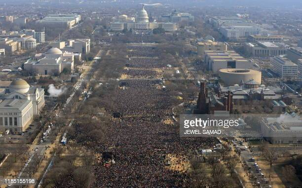 People gather on the National Mall during the inaugural ceremony for Barack Obama as 44th US president at the US Capitol in Washington on January 20,...
