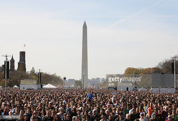People gather on the National Mall in Washington DC on October 30 2010 for television satirists Jon Stewart's and Stephen Colbert's Rally to Restore...