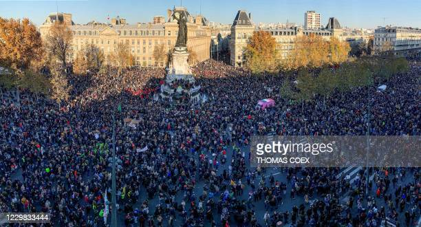 People gather on the Place de La Republique square in central Paris on November 28, 2020 for a demonstration against a new French law on global...