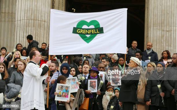 People gather on the steps after the Grenfell Tower National Memorial Service held at St Paul's Cathedral on December 14 2017 in London England The...