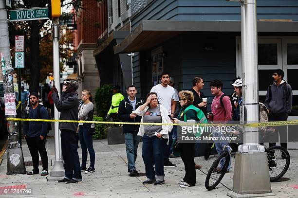People gather on the street after a New Jersey Transit train crashed into the platform at Hoboken Terminal during morning rush hour September 29 2016...