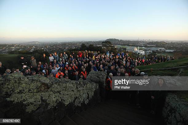 People gather on the summit of One Tree Hill for a tree planting ceremony on June 11 2016 in Auckland New Zealand Six pohutukawa and three totara...