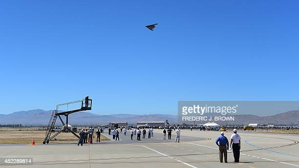 People gather on the tarmac to watch a flyby of a B2 Stealth Bomber at the Palmdale Aircraft Integration Center of Excellence in Palmdale California...
