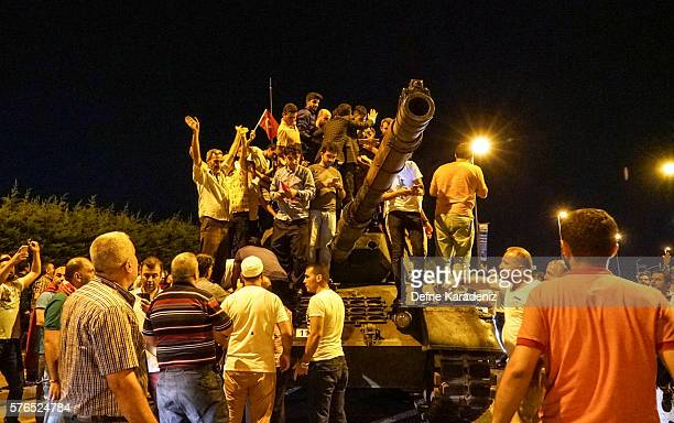 People gather on top of a Turkish armys tanks at Ataturk Airport on July 16 2016 in Istanbul Turkey Istanbul's bridges across the Bosphorus the...