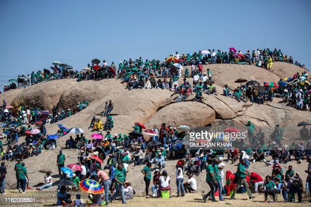 People gather on Wonderkop in Marikana Rustenburg where striking miners were killed during the Marikana Massacre on the morning of August 16 to mark...