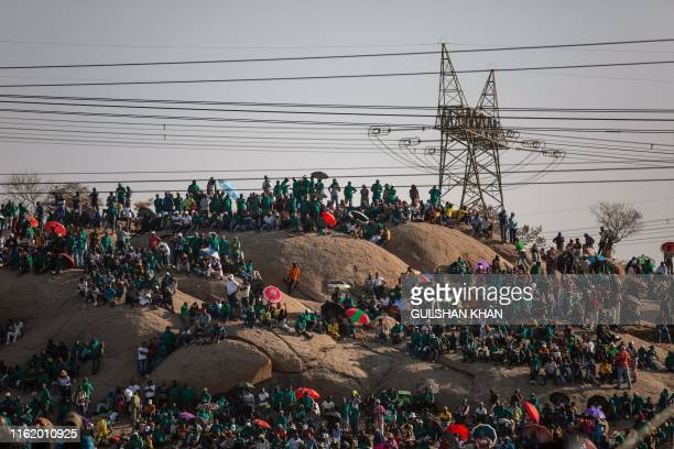 TOPSHOT People gather on Wonderkop in Marikana Rustenburg where striking mineworkers were killed during the Marikana Massacre to mark the event's...