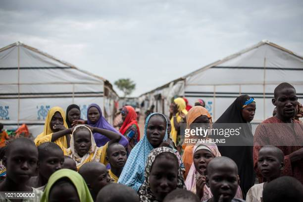 TOPSHOT People gather outside a tent in one of the IDP camps in Pulka on August 1 2018 As the presidential race heats up ahead of February polls the...