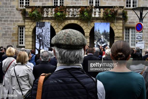 People gather outside Brive-la-Gaillarde city hall, on September, 30 2019, during a ceremony in tribute to former French president Jacques Chirac as...