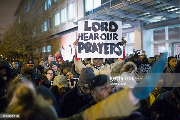 People gather outside Chicago police headquarters for a prayer vigil and demonstration to protest the death and alleged cover-up of Laquan McDonald...