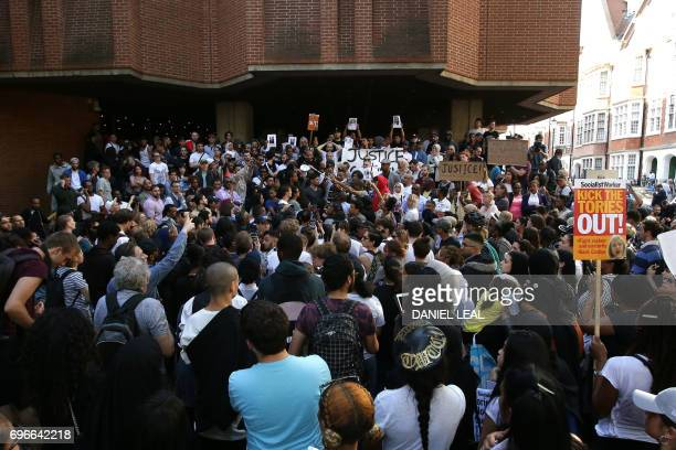 People gather outside Kensington Town Hall on June 16 to demand justice for those affected by the fire that gutted Grenfell Tower a residential tower...