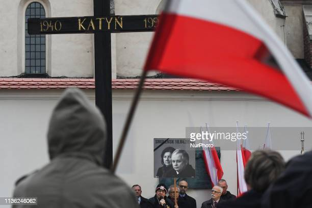 People gather outside of Katyn Cross monument near Wawel Castle on the day of the 9th anniversary of the Smolensk crash disaster In the early hours...