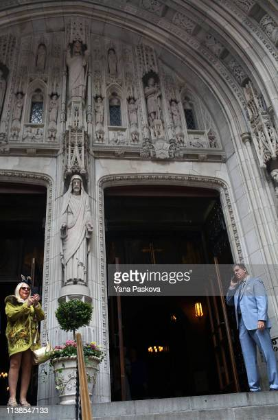 People gather outside of Saint Thomas Church in Midtown East for the annual Easter Parade on April 21 2019 in New York City Each year New Yorkers put...