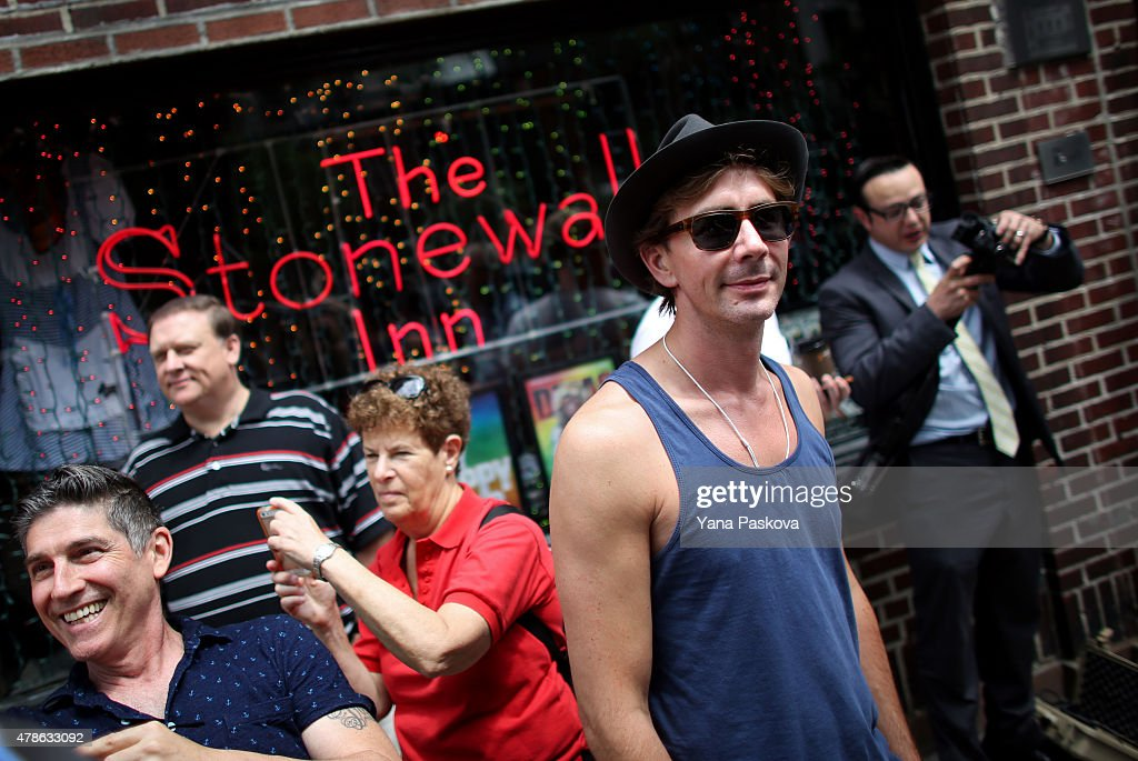 People gather outside of the Stonewall Inn, an iconic gay bar recently granted historic landmark status, on June 26, 2015 in the West Village neighborhood in New York City. The U.S. Supreme Court ruled that same-sex couples have the right marry in all 50 states.