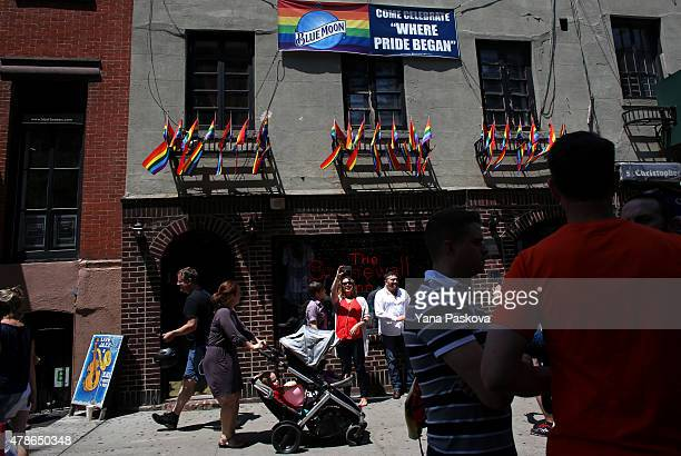 People gather outside of the Stonewall Inn an iconic gay bar recently granted historic landmark status on June 26 2015 in the West Village...