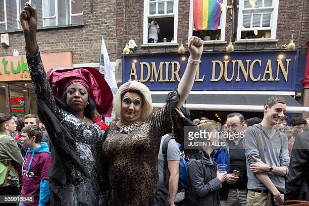 People gather outside the Admiral Duncan pub in Old Compton Street in the Soho district of London for a vigil in commemoration and solidarity with...