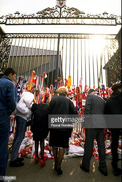 People gather outside the Anfield gates to pay tribute to the people that lost their lives at Hillsborough in 1989. \ Mandatory Credit: Pascal...