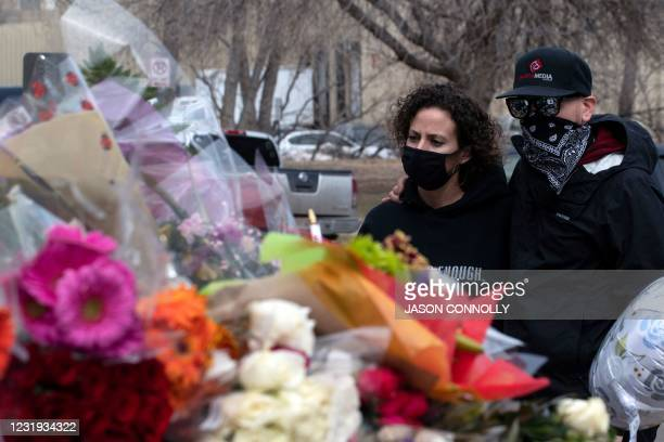 People gather outside the Boulder Police Department in Boulder, Colorado, on March 25, 2021 to pay tribute to Boulder Police officer Eric Talley, who...