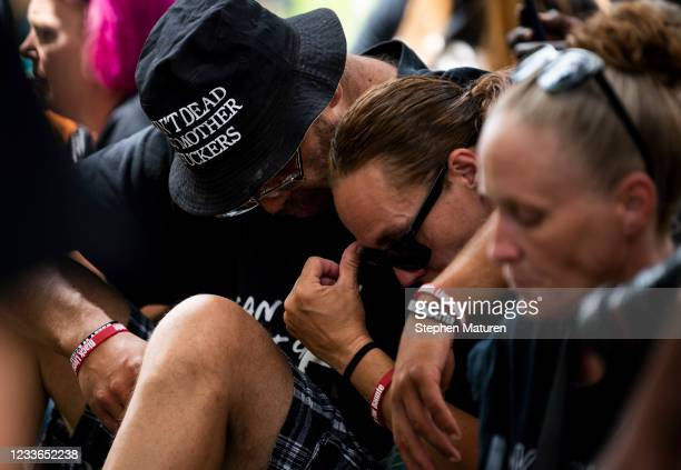 People gather outside the Hennepin County Government Center and listen to victim impact statements during the sentencing of Derek Chauvin on June 25,...