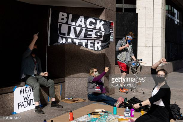 People gather outside the Hennepin County Government Center on March 9, 2021 in Minneapolis, Minnesota. - Jury selection finally got underway on...