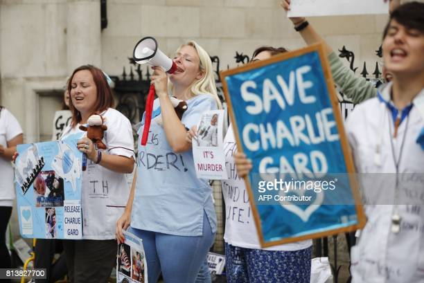 People gather outside the High Court in support of continued medical treatment for criticallyill 11month old Charlie Gard who is due to be taken off...