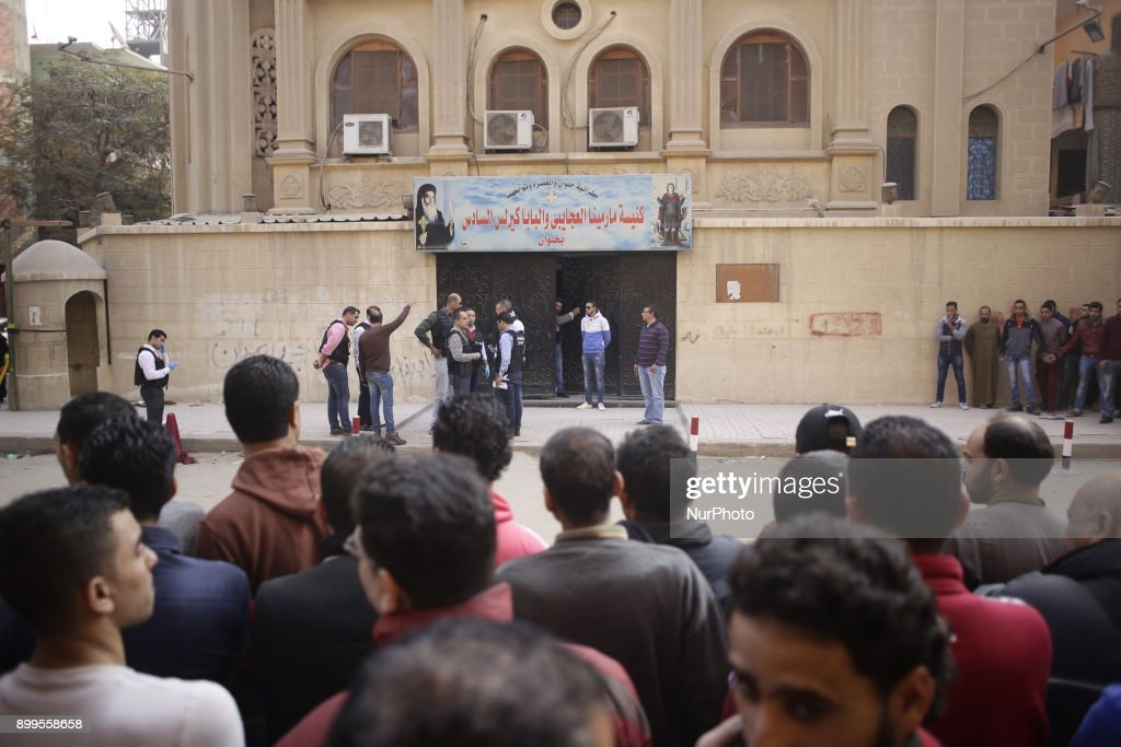 People gather outside the Mar Mina church, following a gun attack on the church in Helwan, Southeastern Cairo, Egypt, 29 December 2017. At least nine people killed among them a police officer and at least another five were injured after two assailants opened fire on the church. Police killed one attacker in an ensuing clash, and another suspect was later arrested.